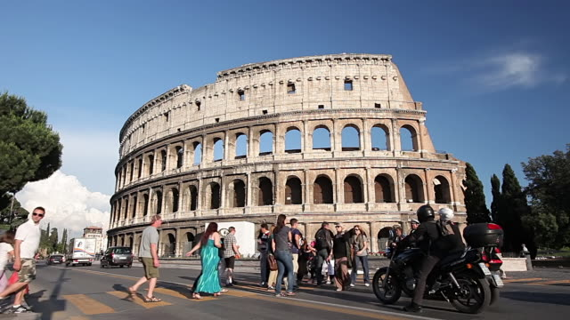 stockvideo's en b-roll-footage met ms shot of pedestrian crossing in front of colosseum / rome, lazio, italy  - colosseum