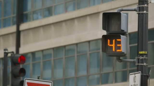 cu shot of pedestrian light changing from red to flashing green man with countdown / washington, district of columbia, united states - walk don't walk signal stock videos and b-roll footage