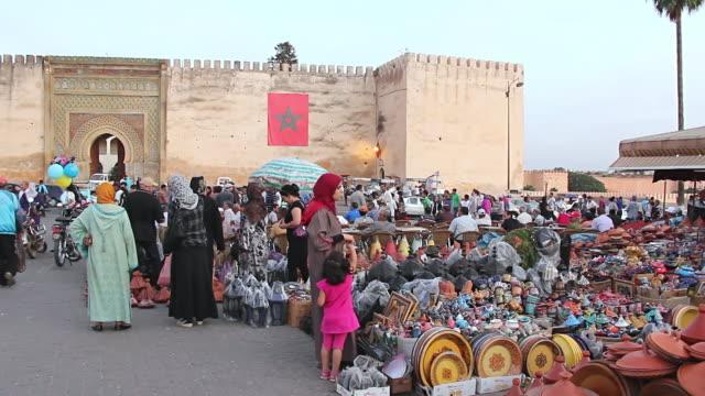 ms pan shot of pedestrian / meknes, morocco - teenage girls stock videos & royalty-free footage