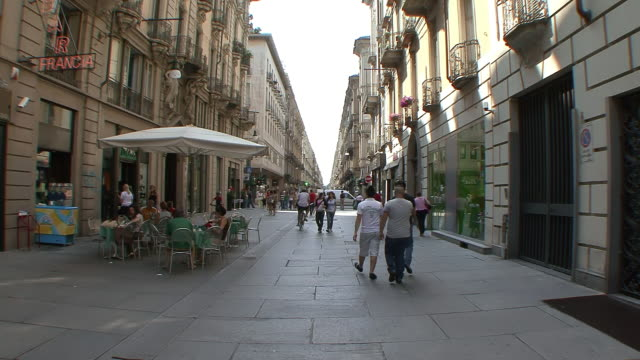 ms shot of pedestrian only shopping street with strollers / turin, piedmont, italy - piedmont italy stock videos & royalty-free footage