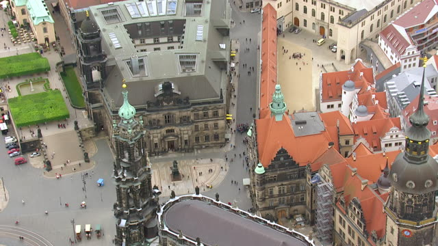 ms aerial shot of pedestrian with roof of hotels in city / dresden, saxony, germany - fußgänger stock-videos und b-roll-filmmaterial