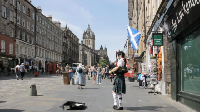 ws shot of pedestrians at royal mile audio / edinburgh, scotland, united states - royal mile stock videos and b-roll footage