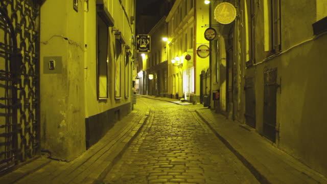 MS R/F Shot of Pedestrians in Alley / Riga, Latvia