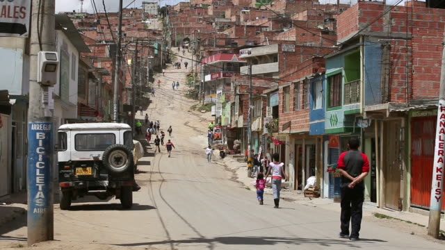 ws shot of pedestrians walking on hilly street in ciudad bolivar slum / bogota, colombia - venezuela stock videos & royalty-free footage