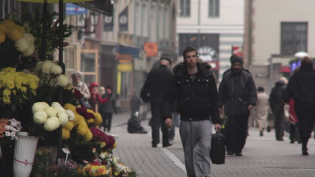 MS Shot of Pedestrians with flower shop / Riga, Latvia