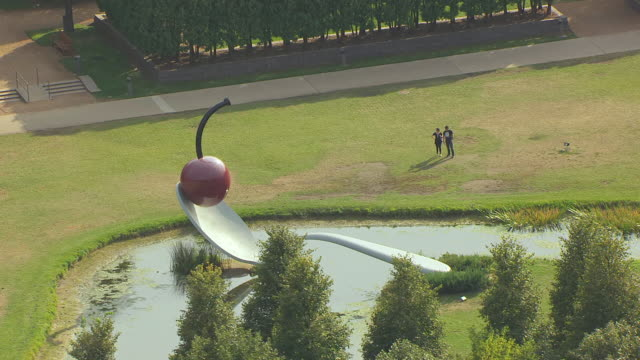 MS AERIAL Shot of people admiring Spoonbridge and Cherry Sculpture at Walker Art Center / Minneapolis, Minnesota, United States