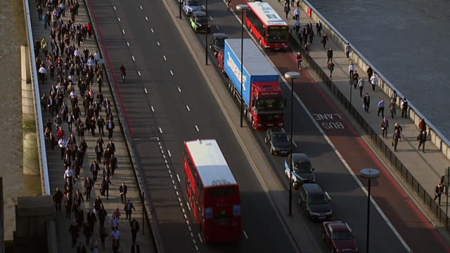 ms shot of people and vehicles crossing london bridge / london, united kingdom  - london bridge england stock videos & royalty-free footage