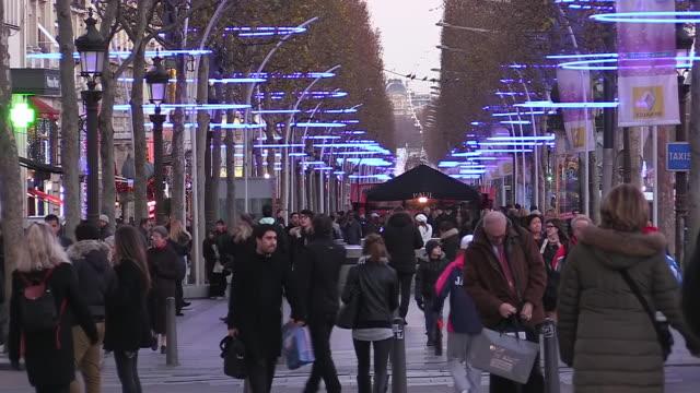 MS Shot of People at Avenue des Champs Elysees / Paris, Ile de France, France