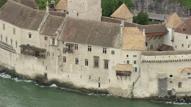 MS AERIAL ZO Shot of people at balcony of chillon castle / Vaud, Switzerland