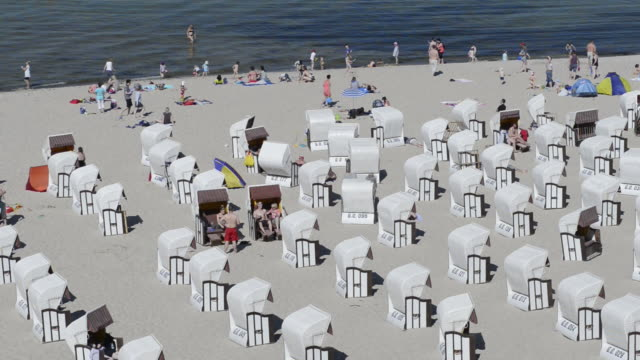 MS Shot of People at Beach with Beach chairs at seaside resort / Sellin, Rugen / Mecklenburg Western Pomerania, Germany