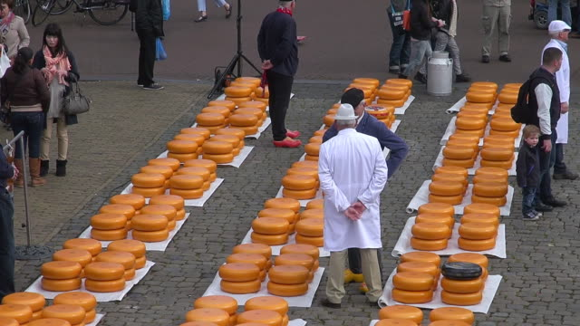 MS Shot of people at cheese market at Market square / Gouda, South Holland, Netherlands