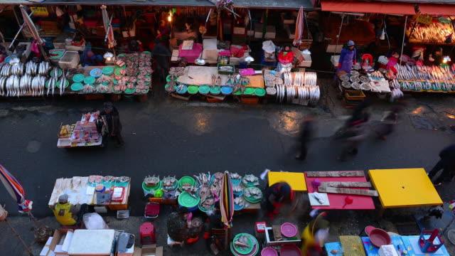 ms t/l shot of people at jagalchi fisheries wholesale market / busan, south korea - busan stock videos & royalty-free footage
