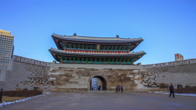 shot of people at namdaemun gate(korea national treasure 1) and clear sky - antiquities stock videos and b-roll footage