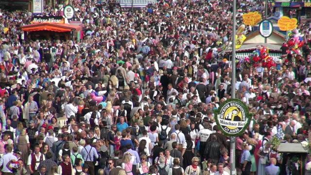 ms shot of people at oktoberfest munich, theresienwiese / munich, bavaria, germany - oktoberfest stock videos & royalty-free footage