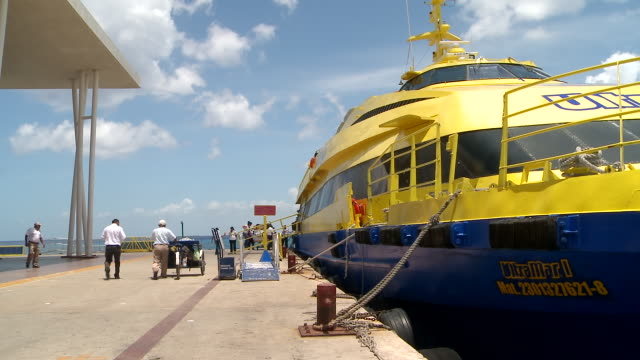 ms shot of people boarding ferry docked on pier / cozumel, quintana roo, mexico - cozumel stock videos and b-roll footage
