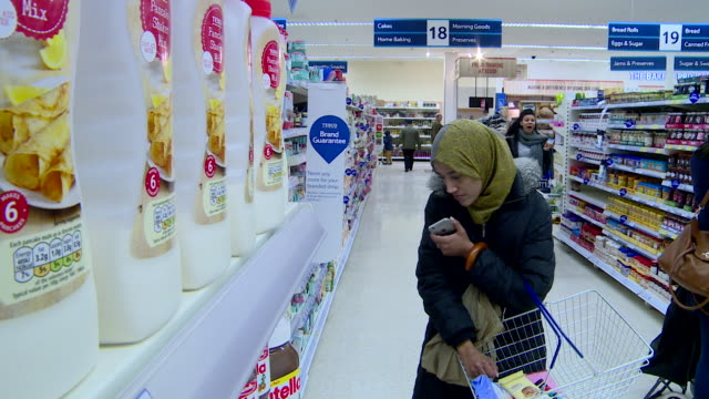 Shot of people browsing the aisles in a Tesco supermarket