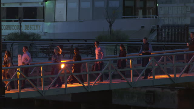 shot of people crossing a bridge to get onto a water taxi at the end of the work day - water taxi stock videos & royalty-free footage