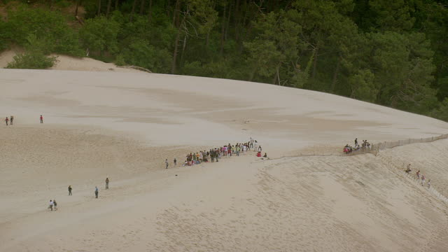 ws aerial shot of people crowd at dune du pilat / aquitaine, france - aquitaine stock-videos und b-roll-filmmaterial