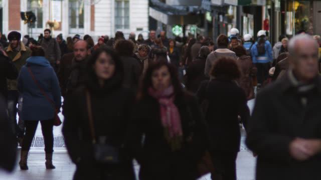 vídeos y material grabado en eventos de stock de ms shot of people crowd walking by on street / madrid, spain - pension