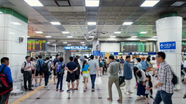 ms t/l shot of people crowded in suwon train station / suwon, gyeonggi do, south korea  - suwon stock videos and b-roll footage