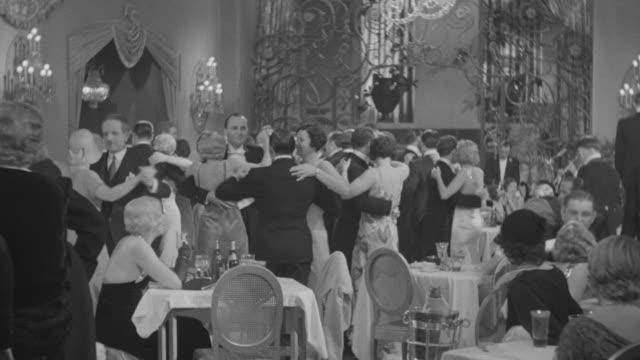 ms shot of people dancing in hotel - 舞踏会点の映像素材/bロール