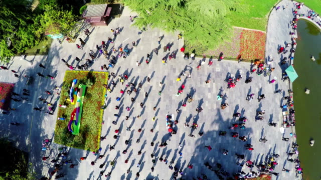 WS AERIAL Shot Of People Dancing In Park Moring Xian Shaanxi