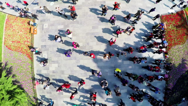 WS AERIAL Shot Of People Dancing In Park MoringXian Shaanxi