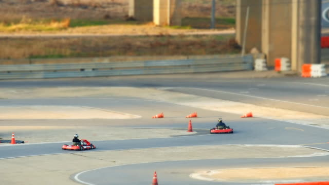ms t/l shot of people doing kart racing around jamsil area / seoul, south korea - go cart stock videos & royalty-free footage