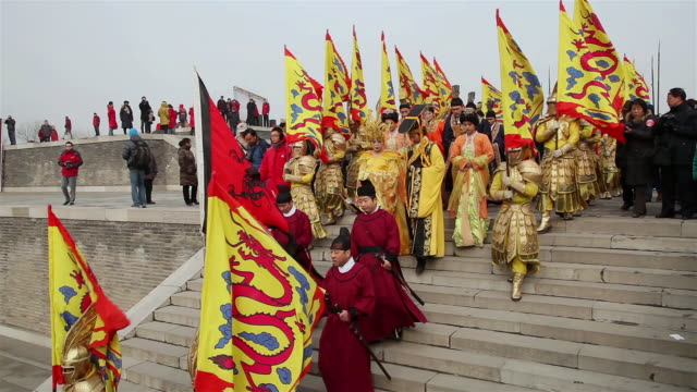 ms shot of people dressed as ancient emperor with queen and officials when hold ceremonies to worship heaven / xian, china - emperor stock videos and b-roll footage
