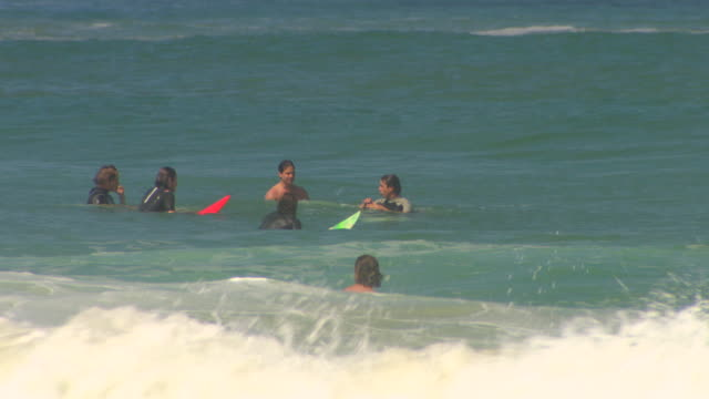 MS Shot of People enjoying and surfing in sea / Biarritz, France