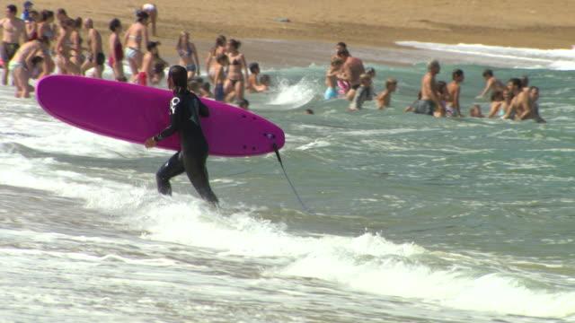 MS Shot of People enjoying at beach / Biarritz, France