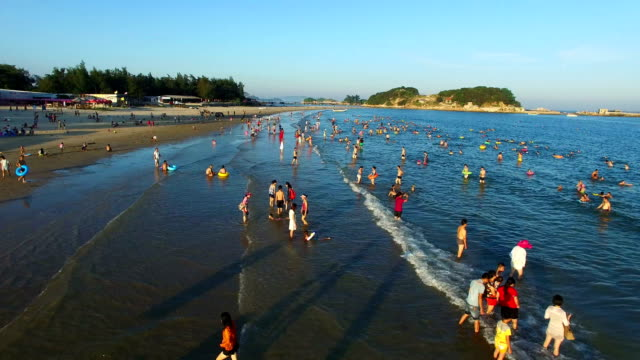 WS AERIAL shot of People enjoying in beach/Fujian,China