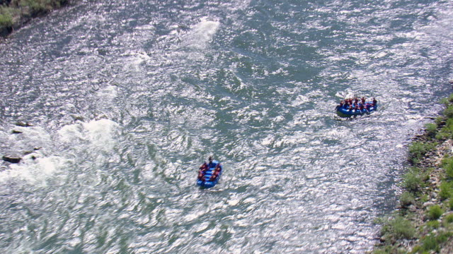 ms aerial td zi shot of people enjoying rafting in yellowstone river / wyoming, united states - river yellowstone stock videos & royalty-free footage