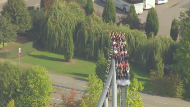 MS AERIAL TS Shot of people enjoying ride in largest theme park / Rust, Baden Wurttemberg, Germany
