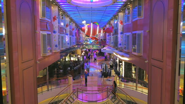 ms shot of people enjoying with shops and color fantasy of color line in ferry ship  / kiel, schleswig-holstein, germany - schleswig holstein stock-videos und b-roll-filmmaterial