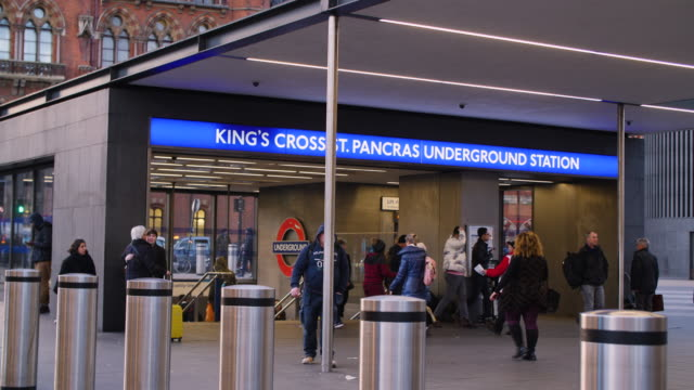 Shot of people entering and leaving Kings Cross and St Pancras underground station.