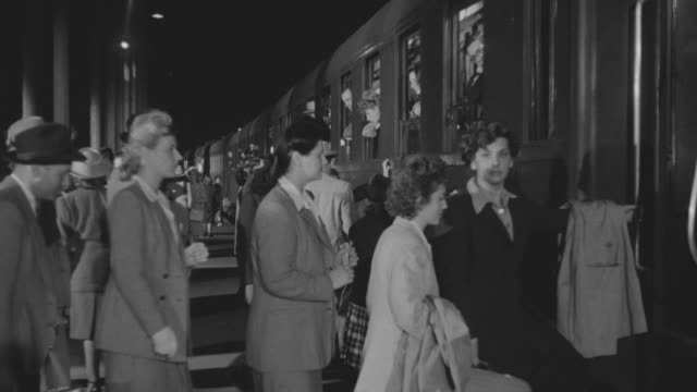 ms shot of people entering in train - passeggero video stock e b–roll