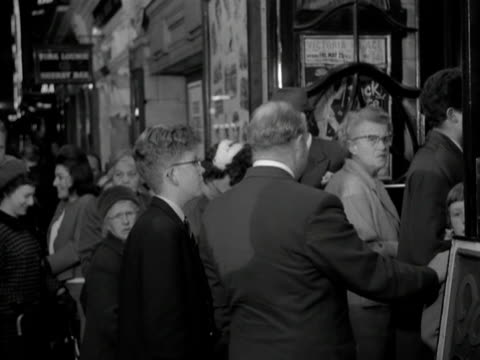 shot of people entering the victoria palace theatre for a performance of the black and white minstrel show. - television show stock videos & royalty-free footage