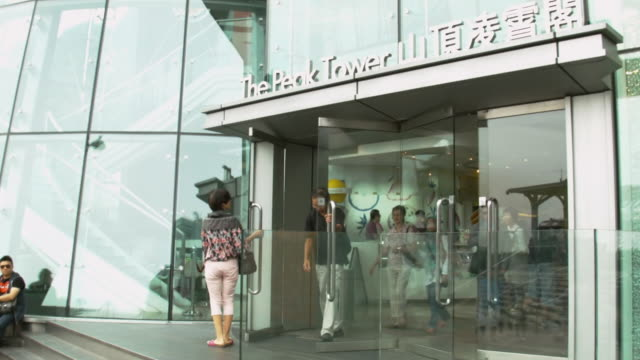 ms shot of people exiting peak tram tower / hong kong, china - peak tower stock videos and b-roll footage