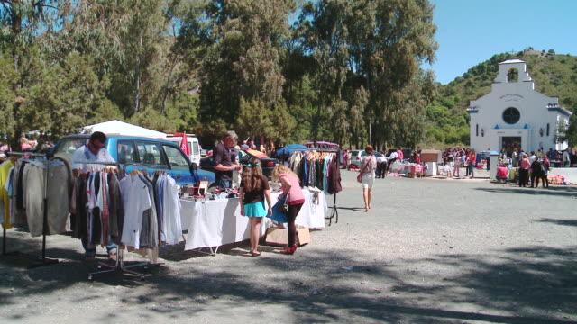 ms pan shot of people in benahavis market at la ermita park / benahavis, malaga, spain - flea market stock videos & royalty-free footage