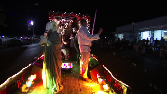 ms pov shot of people in star wars jedi costumes on top of float during roswell ufo festival parade at night / roswell, new mexico, united states - roswell stock videos & royalty-free footage