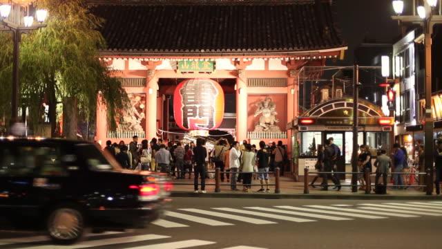 MS Shot of people near kaminarimon sensoji temple in asakusa area at night / Tokyo, Kanto, Japan