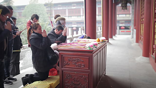 ms shot of people of buddhists pray in temple / xi'an, shaanxi, china - architectural feature stock videos & royalty-free footage