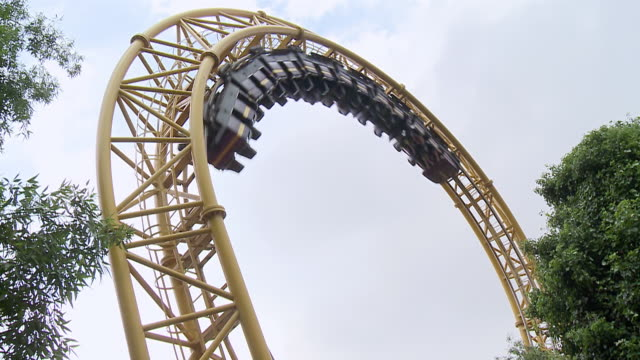 MS Shot of people on rollercoaster in theme park / Johannesburg, Gauteng, South Africa