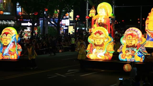 ms shot of people parade with paper lantern on buddha's birthday event on jongro street at night / seoul, south korea - buddha's birthday stock videos and b-roll footage