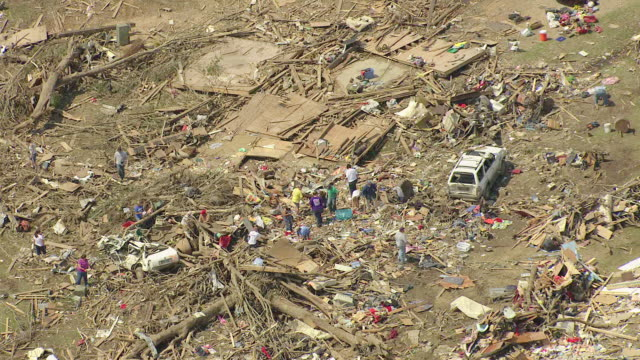 MS ZO AERIAL Shot of people picking through debris and devastation / Smithville, Mississippi, United States