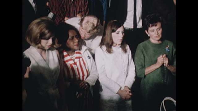 shot of people praying following the shooting of robert kennedy at the ambassador hotel - bbc archive stock-videos und b-roll-filmmaterial