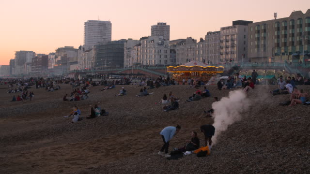 shot of people relaxing on brighton beach at sunset. - bbq stock videos & royalty-free footage