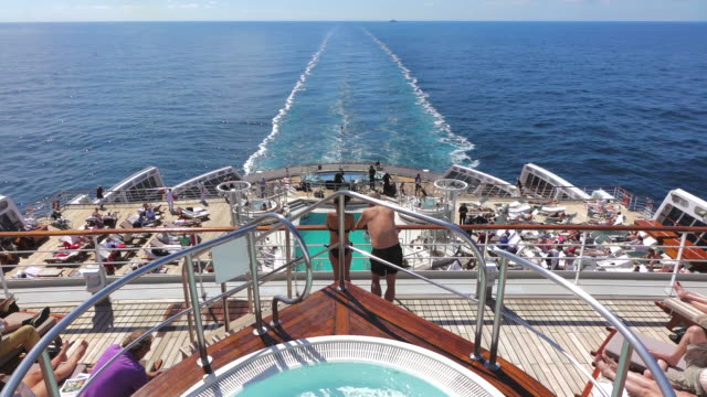 MS POV Shot of People resting and swimming on Cruise ship Queen Mary 2 / Stavanger, Rogaland, Norway