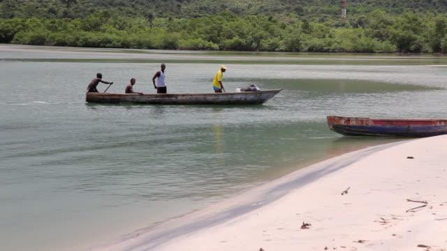 ms ts shot of people riding boat in sea / freetown, sierra leone - sierra leone stock videos & royalty-free footage